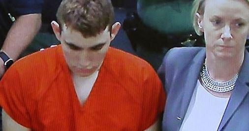 "Shackled And Cowering, ""White Supremacist"" Shooter Confesses"