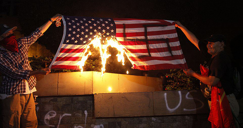 Hondurans Paint Swastika On American Flag, Set It On Fire; Wave Honduran Flags, Give Us The Finger