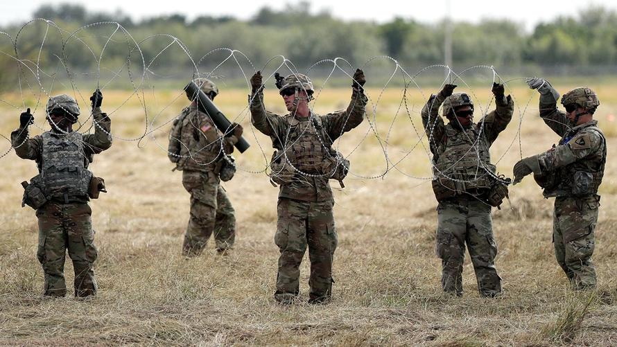 US Troops Lay DownRazor Wire At Southern Border